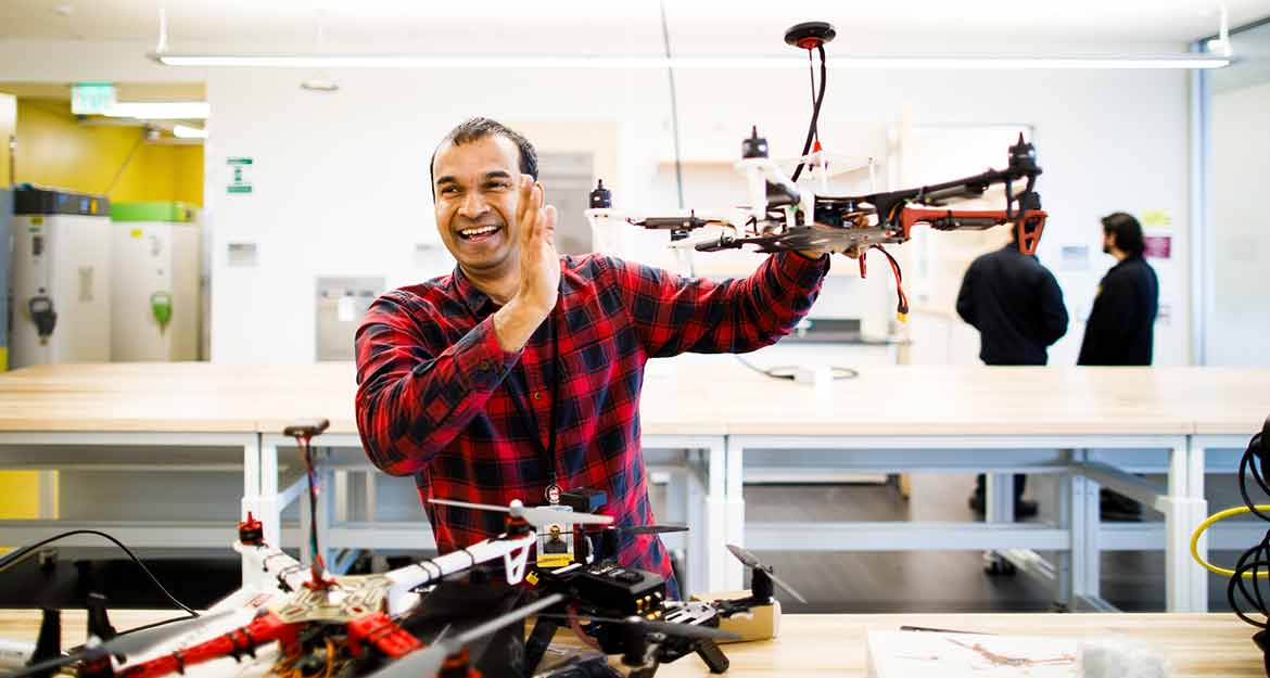Das holds a drone in his lab