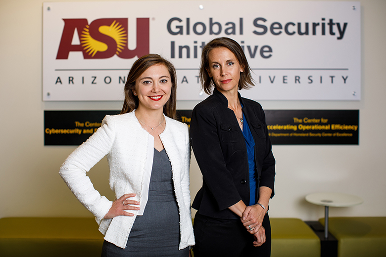 photo of Bliss and Winterton in front of the Global Security Initiative logo