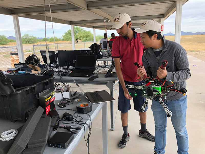 Students calibrate a drone at a 2019 competition