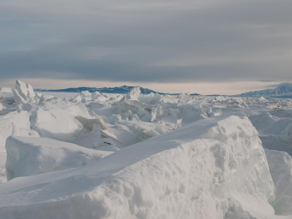 Antarctic ice with mountains in the background