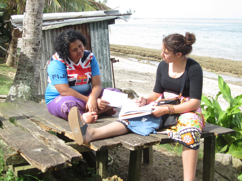 An ASU researcher interviews a woman in Fiji.