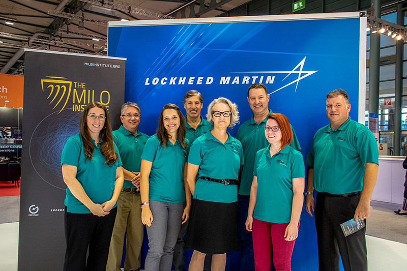 MILO team standing in front of a Lockheed Martin banner at the IAC in Germany
