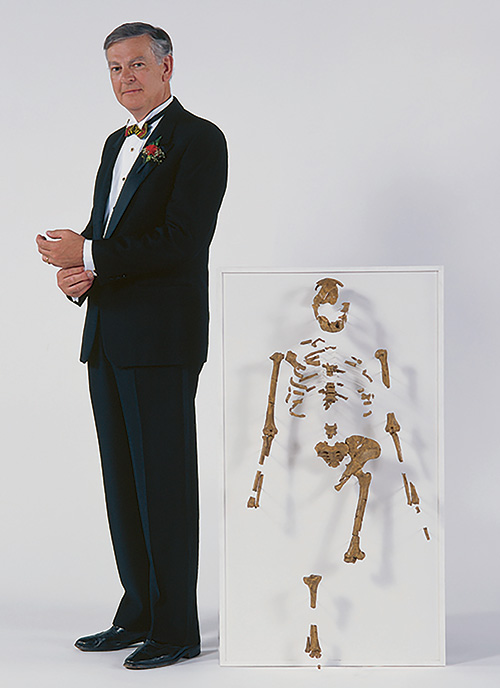 Donald Johanson stands with the Lucy skeleton he discovered