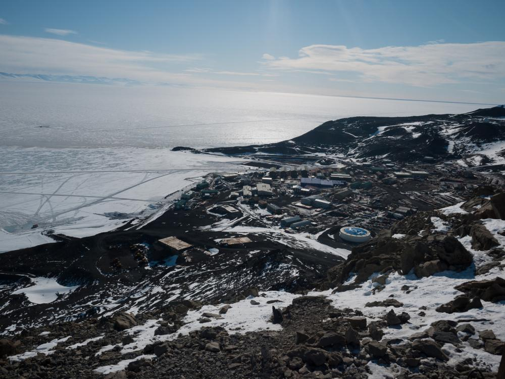 vast antarctic landscape with the U.S. research station as the bottom of the mountain