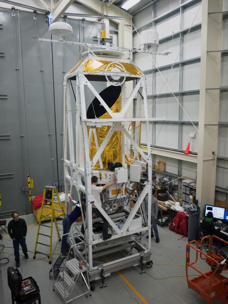 STO2 telescope being worked on by engineers in a large warehouse