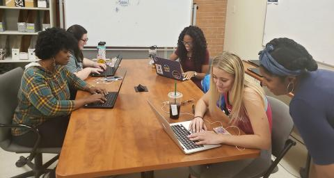 Students code research data in ASU's Center for Global Health
