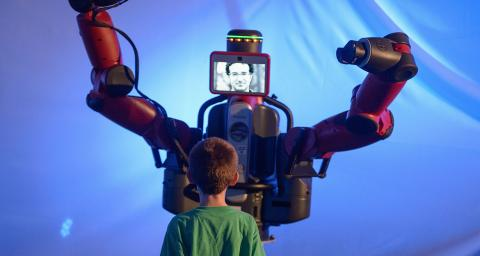 A child interacts with a Baxter robot at ASU Emerge