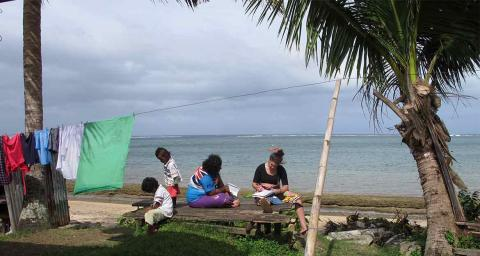 A student researcher gathers data in Fiji for the Global Ethnohydrology Survey. Photo courtesy of Amber Wutich.