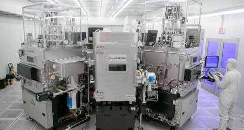 giant silver machine sits within a lab
