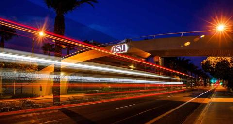 time-lapse photo of car lights going beneath ASU bridge at night
